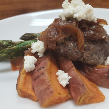 Burger topped with Goat Cheese and Sweet Potato Wedges and Grilled Asparagus