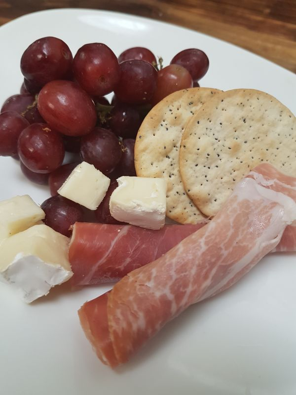Chef's Charcuterie Board served with Brie Cheese, Prosciutto, Grapes and Crackers