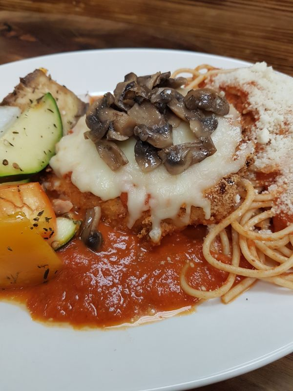 Chicken Parmesan served with Tomato Sauce, Mozzarella over Whole Wheat Pasta and Seasonal Vegetables