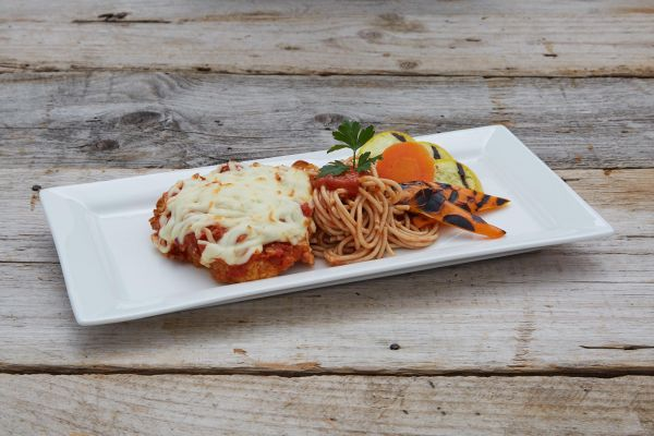 Chicken Parmigiana served with Pasta and Grilled Vegetables.