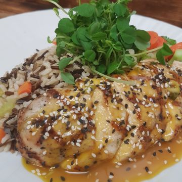 Grilled Chicken in a Sesame Orange Sauce served over a Wild and Brown Rice Pilaf with Seasonal Vegetables