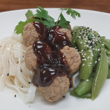 Hoisin Meatballs Served with Thai Noodles and Sautéed Sugar Snap Peas