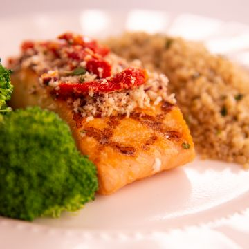 Salmon with Sundried Tomato and Olive Crust served with Herbed Quinoa and Broccoli